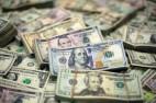 Минимальный курс доллара США составил 63,6475 руб., максимальный - 63,875 руб