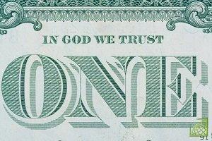 Президент США Дуайт Дэвид Эйзенхауэр в 1956 году подписал закон, согласно которому фраза In God We Trust стала национальным лозунгом США