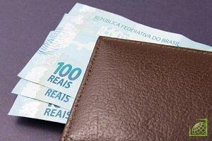 Курс бразильского реала упал в четверг по отношению к доллару до минимального значения за всю историю своего существования